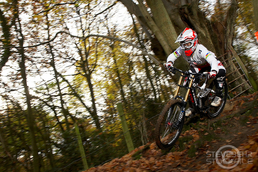 Tracy Moseley riding trek session dh bike in world champions jersey..Moseley family farm , Storridge , nr Malvern , Worcestershire..November 2010 pic copyright Steve Behr / stockfile