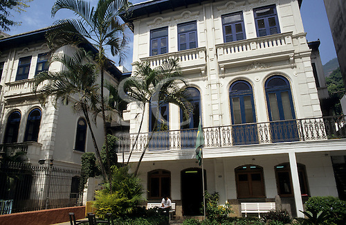 Rio de  Janeiro, Brazil. Large house typical of Laranjeiras district with palm trees and a Brazilian flag in front.
