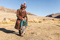 Asia Mongolia, Altai mountain,Saikhsai,  the hunter Saelikhan around his ger with his grandoughter