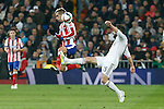 Real Madrid´s Daniel Carvajal (R) and Atletico de Madrid´s Griezmann during Spanish King´s Cup match at Santiago Bernabeu stadium in Madrid, Spain. January 15, 2015. (ALTERPHOTOS/Victor Blanco)