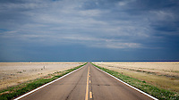 A undeviating road bisects arable land in south west Kansas.
