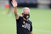 CARY, NC - AUGUST 01: Dave Sarachan waives to the team owner during a game between Birmingham Legion FC and North Carolina FC at Sahlen's Stadium at WakeMed Soccer Park on August 01, 2020 in Cary, North Carolina.