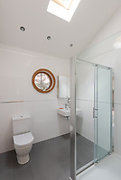 BNPS.co.uk (01202) 558833. <br /> Pic: UniquePropertyCompany/BNPS<br /> <br /> Pictured: Bathroom. <br /> <br /> Haus proud...<br /> <br /> A house designed in German Bavarian style in the south London commuter belt is on the market for £1.1m.<br /> <br /> Holly Lodge, a former pheasant shooting lodge and coaching inn, belonged to an engineer who fell in love with German architecture when he worked in the country.<br /> <br /> He bought and completely redesigned the building in the 1980s.<br /> <br /> The property, which is in the borough of Bromley, has four bedrooms, two bathrooms and two reception rooms.