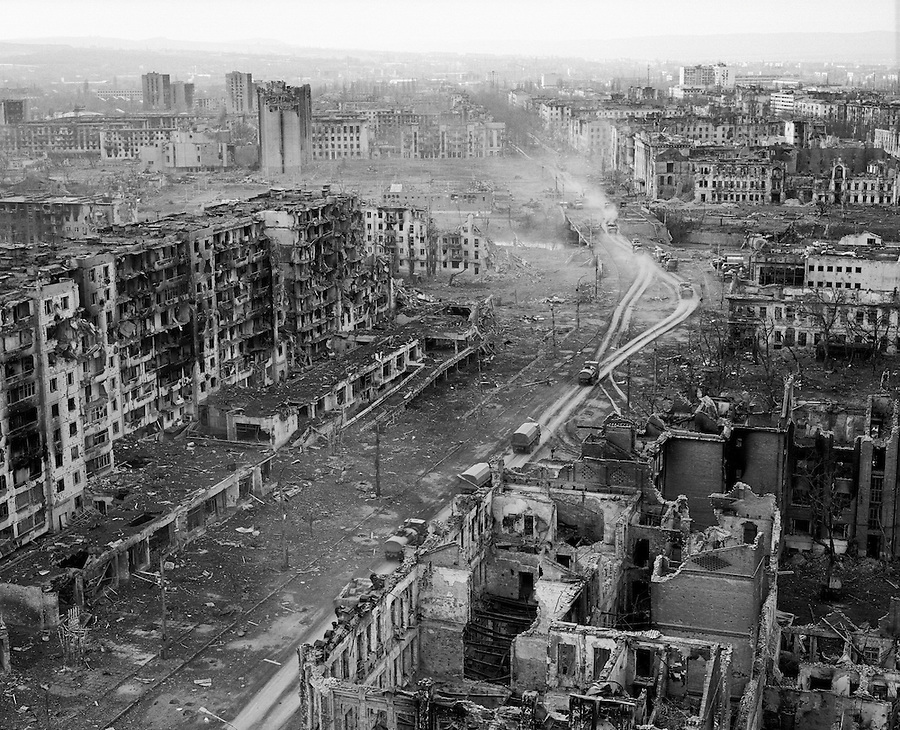 Grozny, Chechnya, March 1995..A Russian military column makes its way through the ruined city centre after rebel forces retreated from the city in the face of the Russian bombardment..