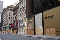 NEW YORK, NEW YORK - JUNE 2: Fronts of jewelry and other luxury stores boarded up along Fifth  Avenue in NYC as preparation against possible looting, The protests spread across the country in at least 30 cities across the United States, over the death of unarmed black man George Floyd at the hands of a police officer, this is the latest death in a series of police deaths of black Americans. (Photo by Stephen Ferry /VIEWpress via Getty Images)