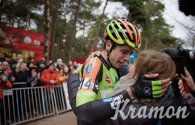 Wout Van Aert (BEL/Crelan-Vastgoedservice) just crossed the finish line as the new Belgian National Champion and overtaken with emotion falls into the arms of his girlfriend Sarah De Bie<br /> <br /> 2016 Belgian National CX Championships