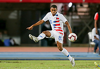 GEORGETOWN, GRAND CAYMAN, CAYMAN ISLANDS - NOVEMBER 19: Reggie Cannon #20 of the United States traps the ball during a game between Cuba and USMNT at Truman Bodden Sports Complex on November 19, 2019 in Georgetown, Grand Cayman.