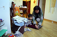 CHINA. Beijing. Li Rui'an (3) and his mother, Elle Hong, at home. Li Rui'an is the second child in the family. In wake of the approaching census, family's are having trouble registering their second child in the one-child state. 2010