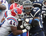 Nevada running back Lampford Mark (29) runs against Louisiana Tech defender Adrien Cole (44) during the first quarter of an NCAA football game Saturday, Nov. 19, 2011, in Reno, Nev. Louisiana Tech won 24-20. (AP Photo/Cathleen Allison)