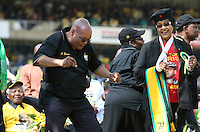 Jacob Zuma and Winnie Madikizela Mandela dance at the African National Congress (ANC) party's final Siyanqoba (victory) rally held at the Ellis Park Stadium in Johannesburg before the 2009 general election. Former president Nelson Mandela is seated behind.