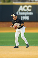Wake Forest Demon Deacons shortstop Pat Blair (11) on defense against the North Carolina State Wolfpack at Wake Forest Baseball Park on March 16, 2013 in Winston-Salem, North Carolina.  The Demon Deacons defeated the Wolfpack 13-4.  (Brian Westerholt/Four Seam Images)