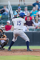 Raimel Tapia (15) of the Asheville Tourists at bat against the Kannapolis Intimidators at CMC-NorthEast Stadium on July 12, 2014 in Kannapolis, North Carolina.  The Tourists defeated the Intimidators 7-5 in 15 innings.  (Brian Westerholt/Four Seam Images)
