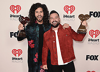 """HOLLYWOOD, CA - MAY 27: Dan + Shay with the award for Best Duo/Group at the 2021 """"iHeartRadio Music Awards"""" airing live from The Dolby Theatre in Los Angeles, Thursday, May 27 (8:00-10:00 PM ET live / PT tape-delayed) on FOX. CR: Scott Kirkland/FOX/PictureGroup © 2021 FOX MEDIA, LLC. (Photo by Scott Kirkland/FOX/PictureGroup)"""