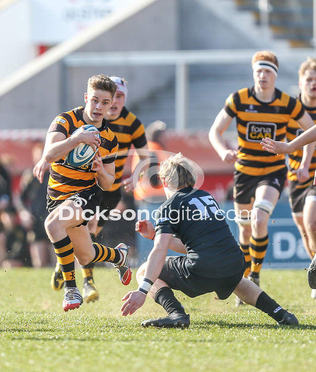 SCF2016 - RBAI vs Campbell College | Thursday 17th March 2016<br /> <br /> RBAI scrum half Rhys O'Donnell is tackled by Ben Webb during the Ulster Schools Cup Final between RBAI and Campbell College at Kingspan Stadium, Ravenhill Park, Belfast, Northern Ireland. Photo credit: John Dickson / DICKSONDIGITAL