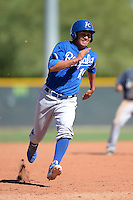 Kansas City Royals third baseman Mauricio Ramos (19) running the bases during an instructional league game against the Seattle Mariners on October 2, 2013 at Surprise Stadium Training Complex in Surprise, Arizona.  (Mike Janes/Four Seam Images)