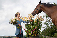 BNPS.co.uk (01202 558833)<br /> Picture: ZacharyCulpin/BNPS<br /> <br /> Horse and flower power...<br /> <br /> Kate White-Hamilton cuts huge Tree Lilies at her flower plot in West Chelborough in Dorset in preparation for the Flower Farmers' Big Weekend as Barney the horse looks on<br /> <br /> Flower farmers across the UK invited the public onto their plots for the third successive year of the Flower Farmers' Big Weekend. The weekendoffered flower-lovers the chance to meet and learn from the local, growers of seasonal, scented British cut flowers on their allotments, cutting gardens, walled gardens and farmland. Thenationwide open flower farm festival staged by growers' association.