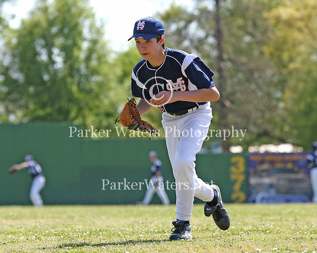 St. Martin's and Country Day square off in district baseball action at Mike Miley. Selected images from pre-game warmups and game action.