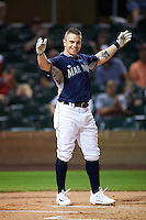 Peoria Javelinas Tyler O'Neill (11), of the Seattle Mariners organization, tosses his hands in the air after becoming the first player to ever hit a home run off a batting tee during the Bowman Hitting Challenge on October 8, 2016 at the Salt River Fields at Talking Stick in Scottsdale, Arizona.  (Mike Janes/Four Seam Images)