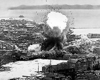Supply warehouses and dock facilities at this important east coast port feel the destructive weight of para-demolition bombs dropped from Fifth Air Force's B-26 Invader light bombers, Wonsan, North Korea. Ca. 1951.  Air Force. (USIA)<br /> Exact Date Shot Unknown<br /> NARA FILE #:  306-PS-51-10303<br /> WAR & CONFLICT BOOK #:  1443