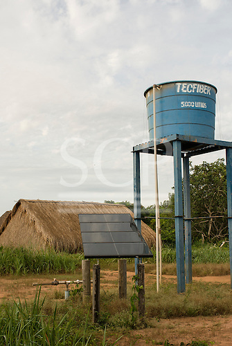Xingu Indigenous Park, Mato Grosso State, Brazil. Aldeia Afukuri (Kuikuro); Groundwater well with solar-powered pump and storage tank, the village water supply.