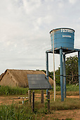 Xingu Indigenous Park, Mato Grosso State, Brazil. Aldeia Afukuri (Kuikuro); Groundwater well with solar-powered pump and storage tank, the village water supply.