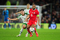Callum O'Dowda of Republic of Ireland vies for possession with Ashley Williams of Wales during the UEFA Nations League B match between Wales and Ireland at Cardiff City Stadium in Cardiff, Wales, UK.September 6, 2018
