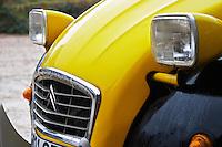 An old black and yellow Citroen 2CV 2 CV, detail of the front headlight Domaine la Tourade, André Andre Richard, Gigondas, Vacqueyras, Vaucluse, Provence, France, Europe