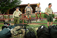 Photo story of Philmont Scout Ranch in Cimarron, New Mexico, taken during a Boy Scout Troop backpack trip in the summer of 2013. Photo is part of a comprehensive picture package which shows in-depth photography of a BSA Ventures crew on a trek. In this photo,  a newly arrived BSA  Venture Crew waits for instructions from their crew leader after arriving at Philmont Scout Ranch,  in Cimarron, New Mexico.<br /> <br /> Photo by travel photograph: PatrickschneiderPhoto.com