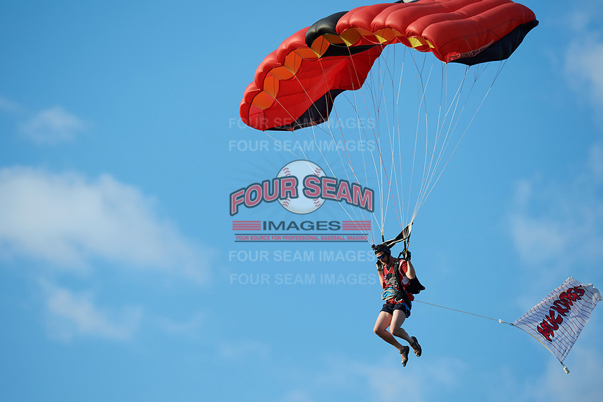 A skydiver descends to the outfield carrying a Batavia Muckdogs flag before a game against the Auburn Doubledays on June 19, 2017 at Dwyer Stadium in Batavia, New York.  Batavia defeated Auburn 8-2 in both teams opening game of the season.  (Mike Janes/Four Seam Images)