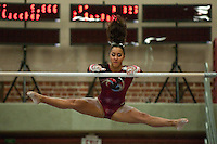 STANFORD, CA-JANUARY 22, 2012 - Ashley Morgan executes her bars routine en route to Stanford's win over the visiting University of Washington Gym Dawgs at Burnham Pavilion on the Stanford Campus.