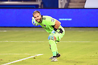KANSAS CITY, UNITED STATES - AUGUST 25: Marko Maric #1 of Houston Dynamo rolls out the ball  a game between Houston Dynamo and Sporting Kansas City at Children's Mercy Park on August 25, 2020 in Kansas City, Kansas.