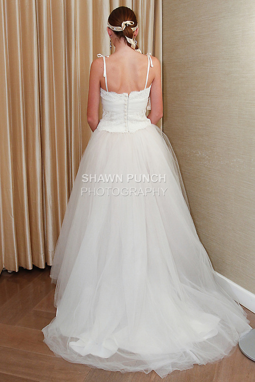 Model poses in a Georgiana wedding gown from the Pixton Couture Bridal Spring 2014 collection, by Kimberly Pixton Millar, during New York Bridal Market Week Spring 2014.