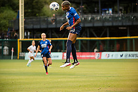 TACOMA, WA - JULY 31: Tziarra King #23 of the OL Reign goes up for a header during a game between Racing Louisville FC and OL Reign at Cheney Stadium on July 31, 2021 in Tacoma, Washington.