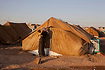 DOMIZ, IRAQ: A mother and child in the Domiz refugee camp...Over 7,000 Syrian Kurds have fled the violence in Syria and are living in the Domiz refugee camp in the semi-autonomous region of Iraqi Kurdistan...Photo by Ali Arkady/Metrography
