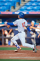 St. Lucie Mets shortstop Andres Gimenez (12) follows through on a swing during the first game of a doubleheader against the Charlotte Stone Crabs on April 24, 2018 at First Data Field in Port St. Lucie, Florida.  St. Lucie defeated Charlotte 5-3.  (Mike Janes/Four Seam Images)