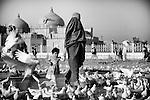 A woman and child walk near the Blue Mosque in Mazar-e Sharif, 26 September 2013. (John D McHugh)