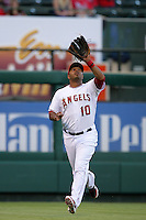 Los Angeles Angels outfielder Vernon Wells #10 waits to catch a fly ball during a game against the Seattle Mariners at Angel Stadium on July 9, 2011 in Anaheim,California. (Larry Goren/Four Seam Images)
