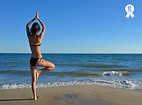 Young girl (16) practicing yoga at beach (Licence this image exclusively with Getty: http://www.gettyimages.com/detail/103544603 )