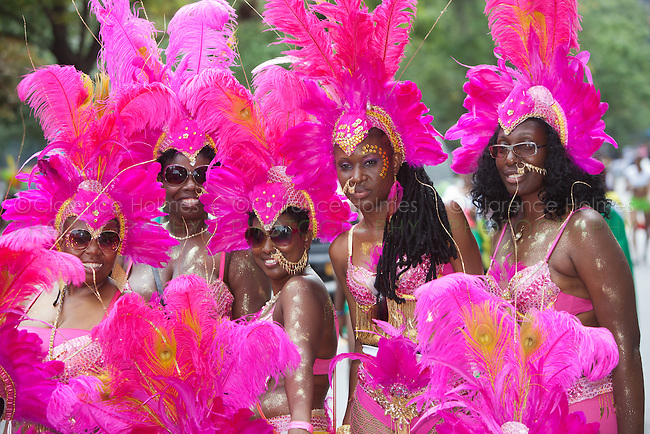 A group of parade participants in festive attire at the West Indian American Day Parade held on Monday, September 5, 2011 in Crown Heights, Brooklyn, New York.  The annual Labor Day event, which runs along Eastern Parkway, celebrates West Indian heritage and attracts 2-3 million spectators.