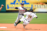 Fort Myers Miracle shortstop A.J. Pettersen #1 attempts to turn a double play as Willy Garcia #24 slides in during a game against the Bradenton Marauders at McKechnie Field on April 7, 2013 in Bradenton, Florida.  Fort Myers defeated Bradenton 9-8 in ten innings.  (Mike Janes/Four Seam Images)