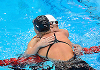 July 28, 2012: Shiwen Ye of China and Elizabeth of USA embrace after competing in Women's 400 meter individual medley at the Aquatics Center on day one of 2012 Olympic Games in London, United Kingdom.