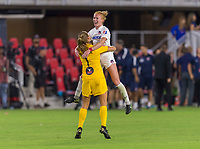 WASHINGTON, DC - AUGUST 25: Aubrey Bledsoe #1 of the Washington Spirit celebrates with teammate Tori Huster #23 during a game between Orlando Pride and Washington Spirit at Audi Field on August 24, 2019 in Washington, DC.