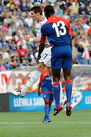 Kenny Cooper (17) of the United States (USA) and Pierre Bruny (13) of Haiti (HAI). The United States and Haiti played to a 2-2 tie during a CONCACAF Gold Cup Group B group stage match at Gillette Stadium in Foxborough, MA, on July 11, 2009. .