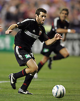 9 April 2005. Dc United midfielder Ben Olsen (14) concentrates on the ball  at RFK Stadium in Washington, DC.
