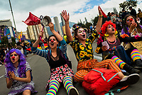 Students of the Universidad Nacional de Colombia, wearing clown costumes, take part in a protest march against government's policies and corruption within the public educational system in Bogotá, Colombia, 24 October 2019.