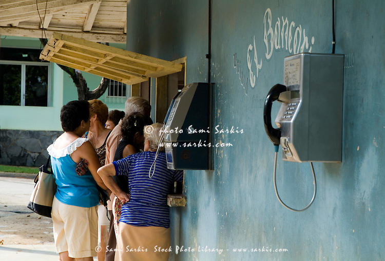 Frustrated people waiting at a shop on the main street of Vinales, Cuba.