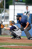 July 30, 2009: Home plate umpire Aaron Larsen and catcher Craig Parry of the State College Spikes during a game at Russell Diethrick Park in Jamestown, NY.  NY-Penn League Short-Season Single-A.  Photo By Mike Janes/Four Seam Images