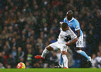 Wayne Routledge of Swansea City and Eliaquim Mangala of Manchester City during the Barclays Premier League match between Manchester City and Swansea City played at the Etihad Stadium, Manchester on December 12th 2015