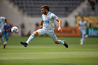 LOS ANGELES, CA - MAY 29: Diego Rossi #9 of LAFC fly's through the air with a ball during a game between New York City FC and Los Angeles FC at Banc of California Stadium on May 29, 2021 in Los Angeles, California.
