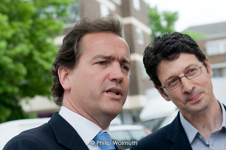 Conservative MP Nick Hurd, newly appointed Minister for Civil Society, talks with Neighbourhood Manager Marco Torquati during a visit to projects in Church Street, London,  supported by the Paddington Development Trust.